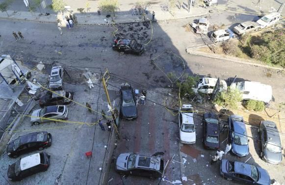 A suicide bomber blew his car in Beirut killing a security officer and wounding several others