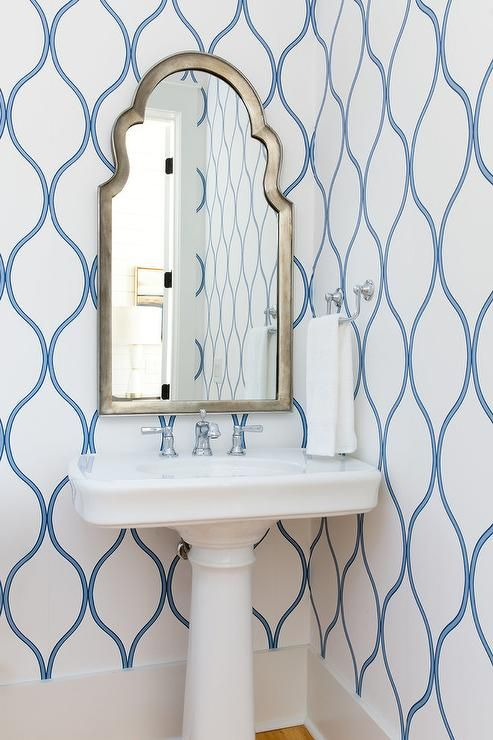 Silver Arch Powder Room Mirror Over A White Pedestal Sink Display Against A  Blue And White