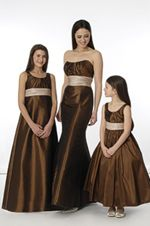 Dress to the left is the junior bridesmaid dress and middle one is the bridesmaids... in pink!