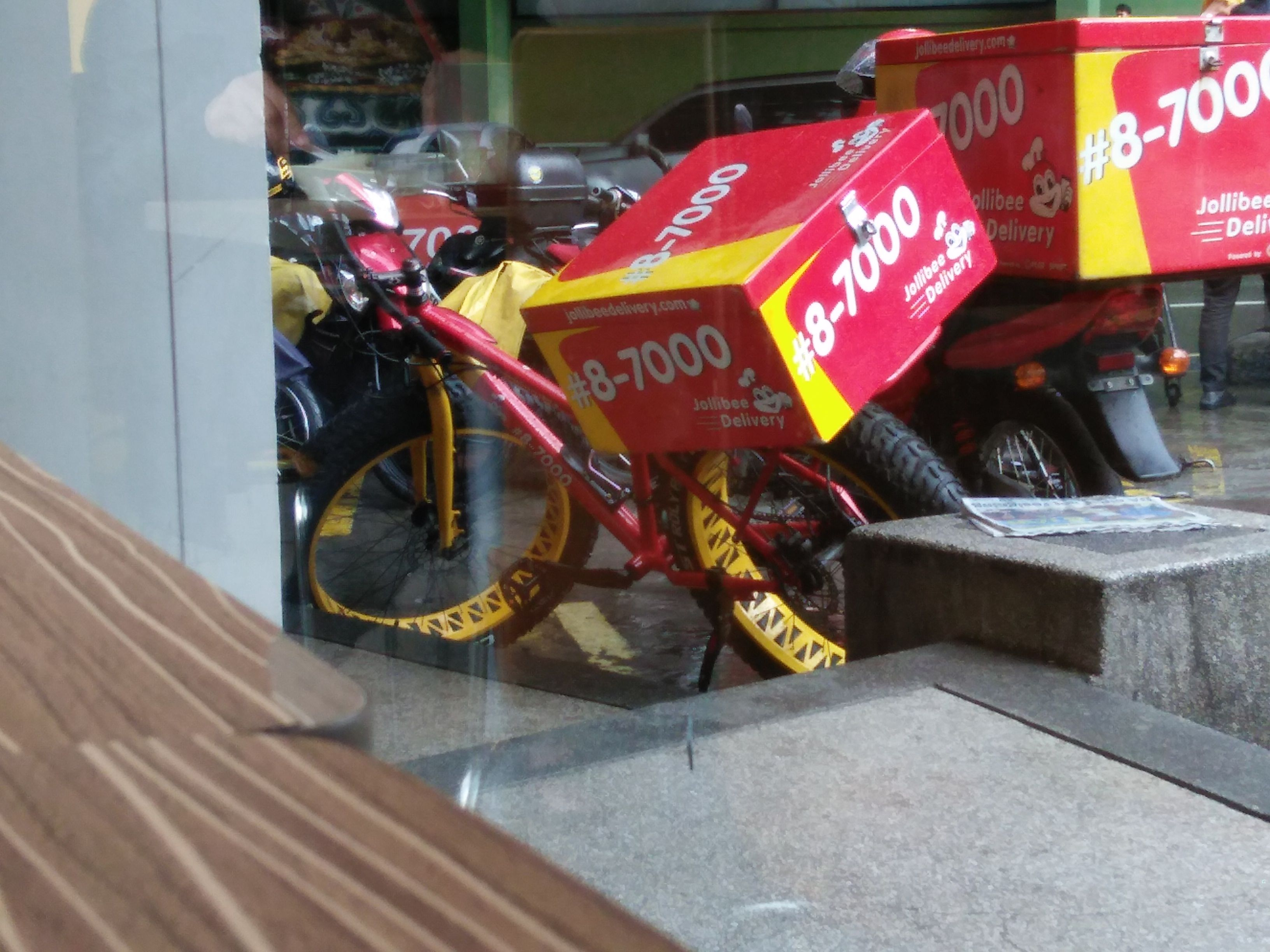 Fast food deliveryon a bike jollibee food delivery