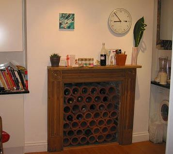 Working Your Non-working Fireplace | Wine rack, Apartment therapy ...