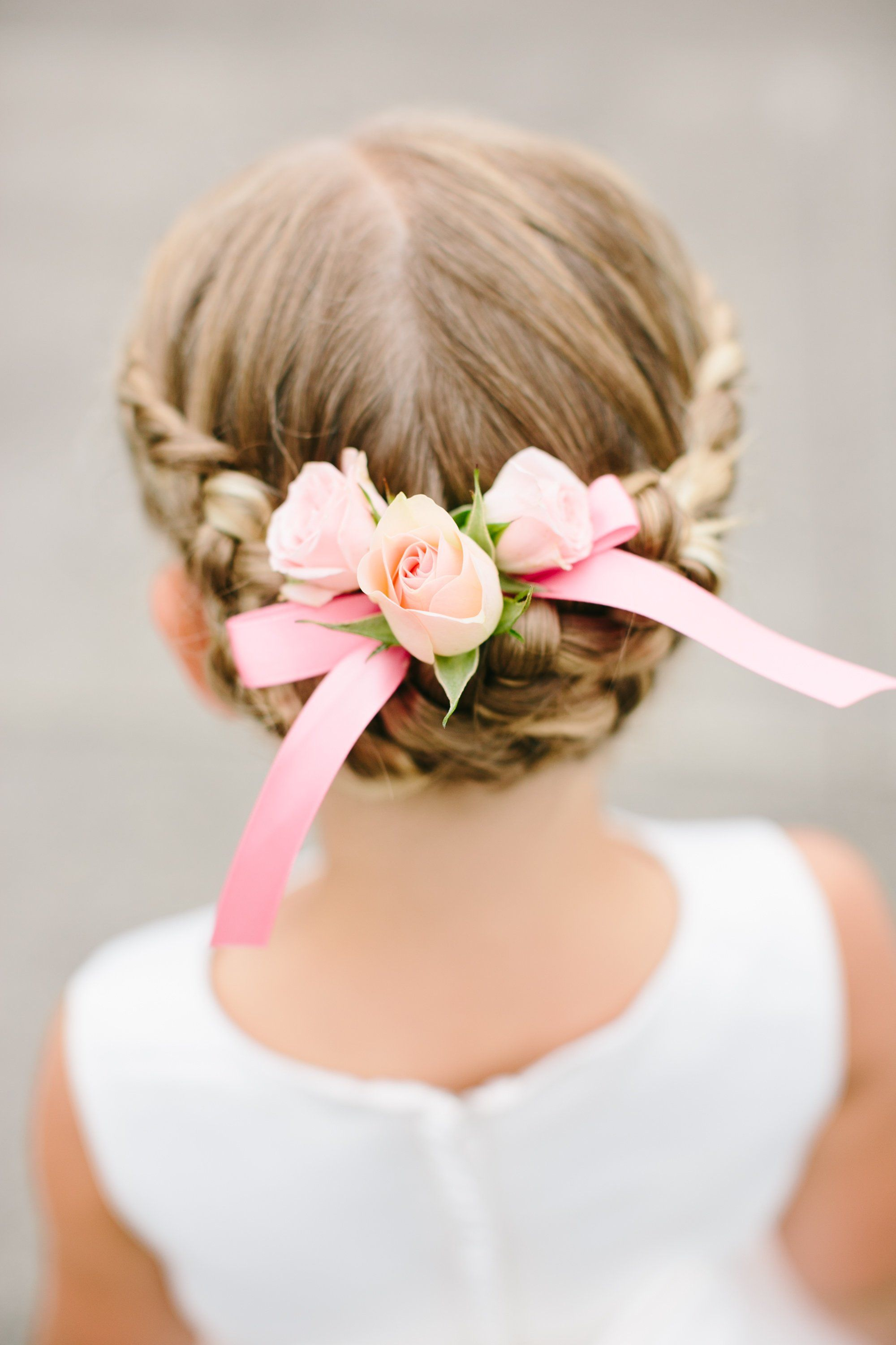 Braided Flower Girl Updo With Floral Accent Cute Little Girl Hairstyles Flower Girl Updo Flower Girl Hairstyles