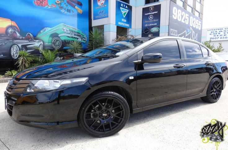 Honda City With Xxr 530 Flat Black Wheels