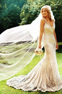 the lovely kate moss in her custom-made wedding dress by John Galliano.  Sheer panels and covered in sparkle. ADORE.