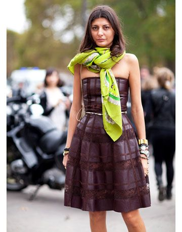 Giovanna Battaglia accessorizes her burgundy Valentino dress with a neon green Hermes scarf.