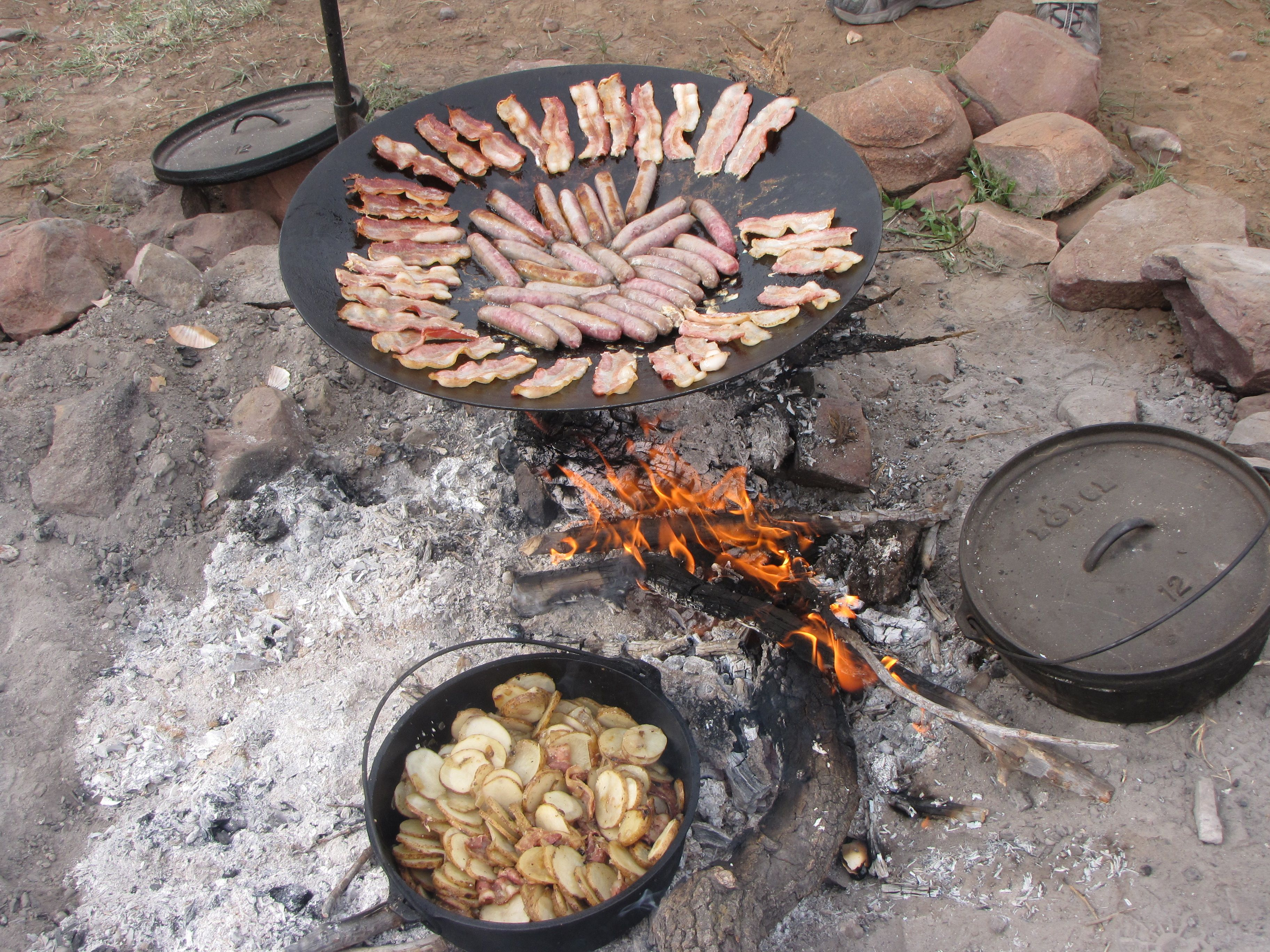 This is real camp fire cooking! No tin foil packets. Cast iron Dutch ovens and a homemade wok! YUMMY!!