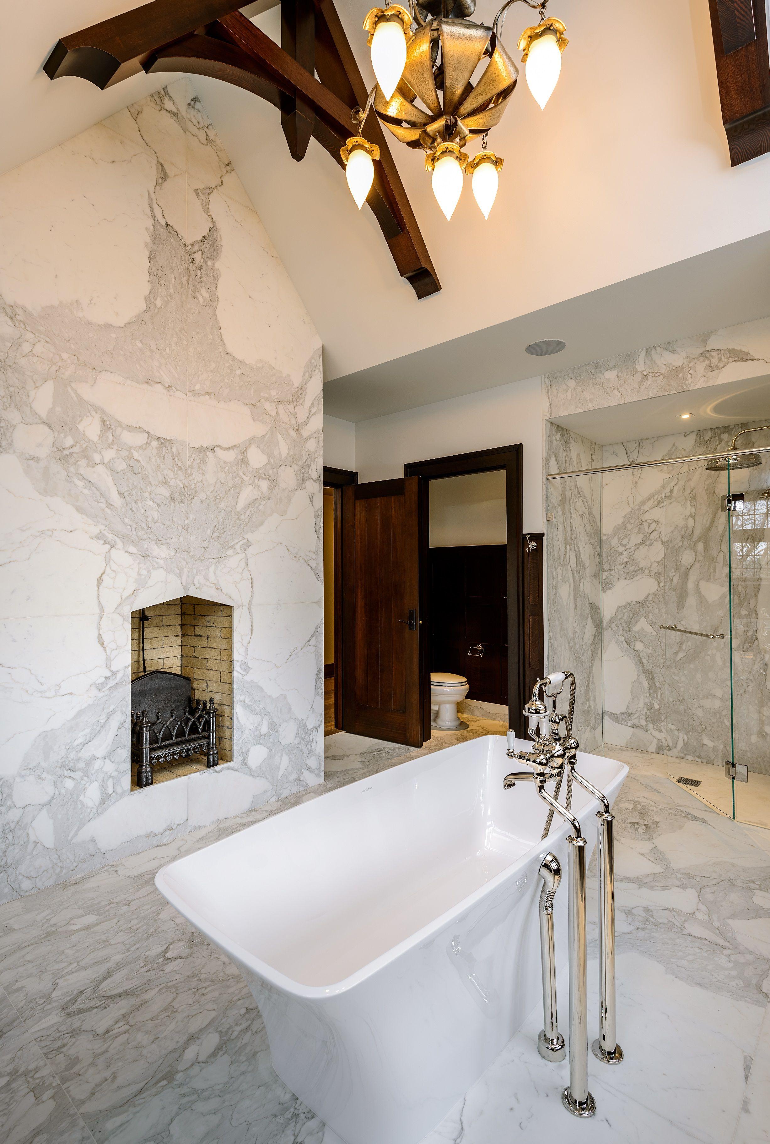 bathroom wall facing in calacatta marble with custom built sink in
