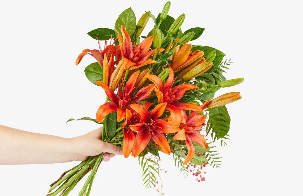 Image result for orange lily flower arrangement orange
