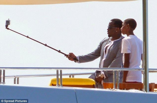 Diddy-group-picture-selfie-stick-hub