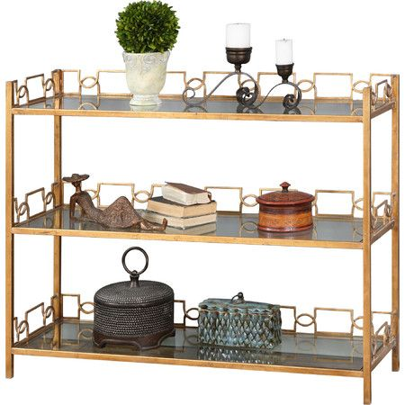 Perfect placed behind your sofa or along the entryway wall, this rustic console table is crafted from iron and showcases glass shelves.