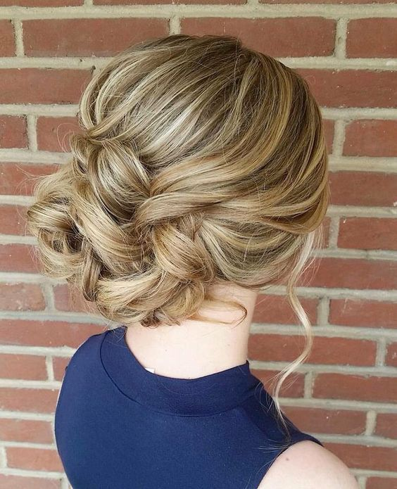 messy hair updo with beads prom