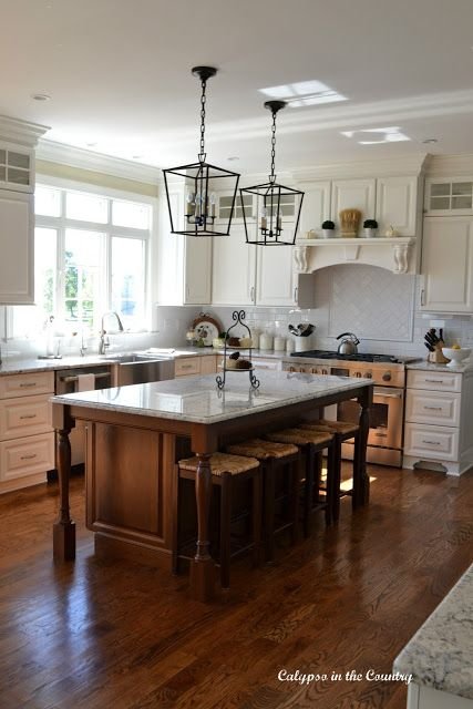 White Kitchen With Cherry Island And Rush Seat Stools White