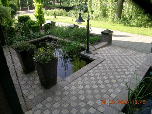Front entrance to townhouse with small fish pond | Pond ...