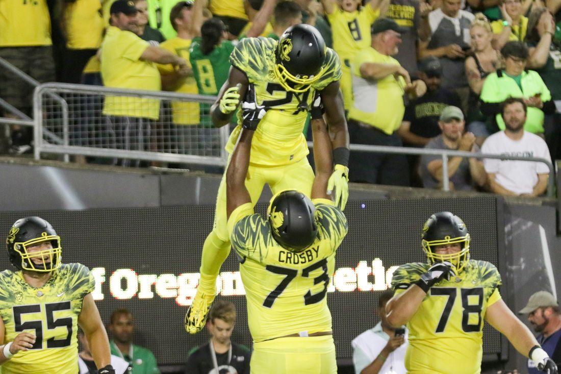Oregon Ducks running back Royce Freeman (21) is lifted up