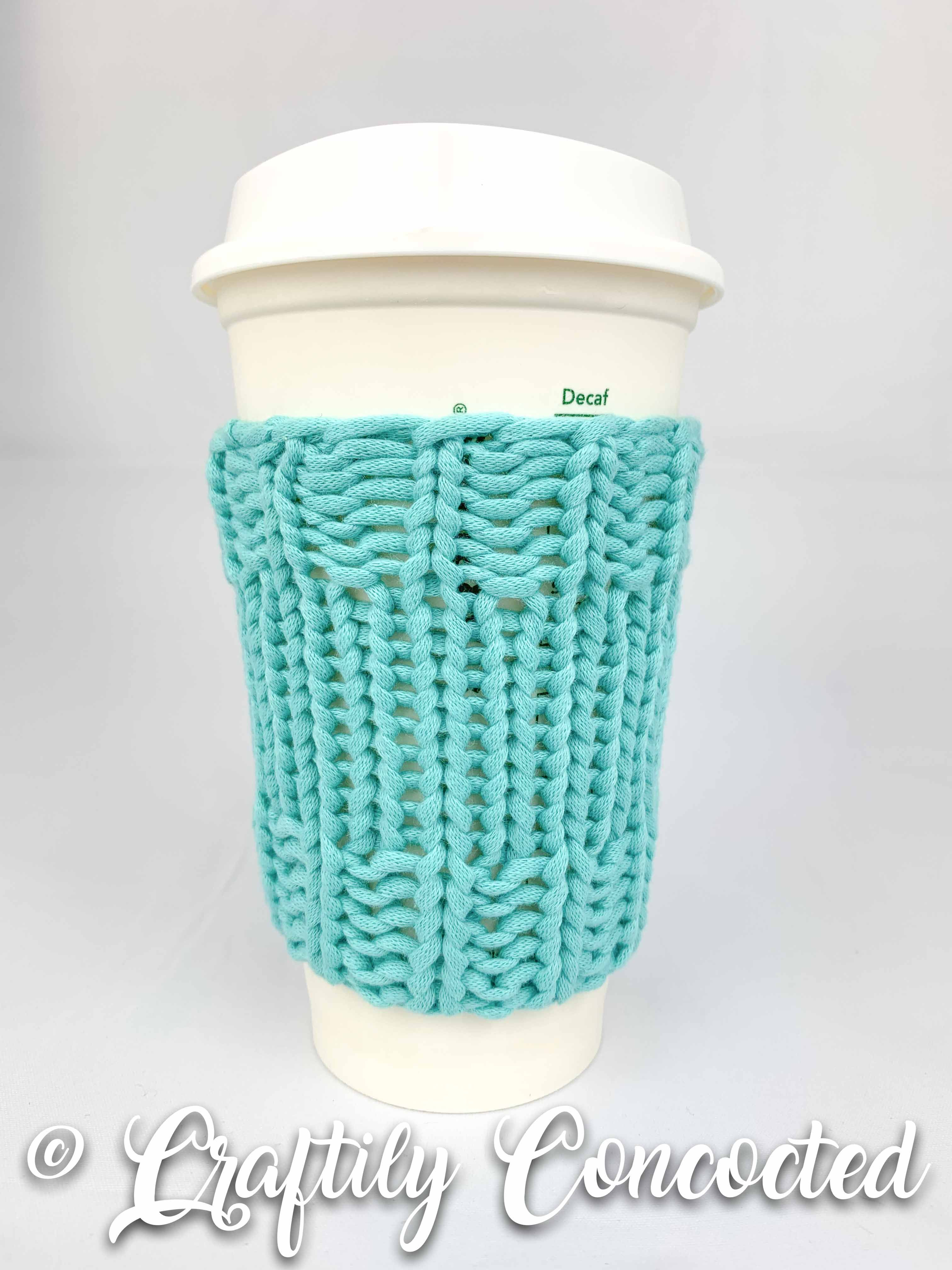 Keep your hands safe from hot Starbucks coffee with this knitted coffee cup cozy.  This coffee cup sleeve fits most sizes of travel cups. #coffeeloversunite #coffeefirst #coffee #musthavecoffee #coffeecupcozy #travelmug #havecoffeewilltravel #starbucks #coffeecup #cupcozy