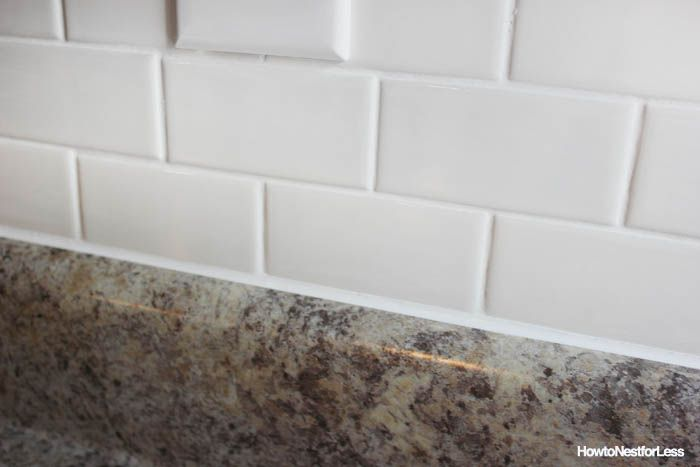 How To Caulk Like A Pro Tutorial How To Nest For Less Home Custom Caulking Kitchen Backsplash
