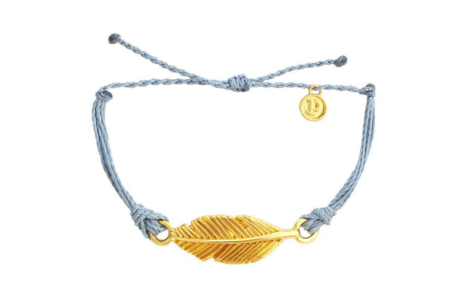 "Our gold ""Feather"" charm is the perfect bracelet to add to your Pura Vida collection. Let the wind guide you with this blue and gold bracelet; a classy combination for the free spirit in all of us. Th"