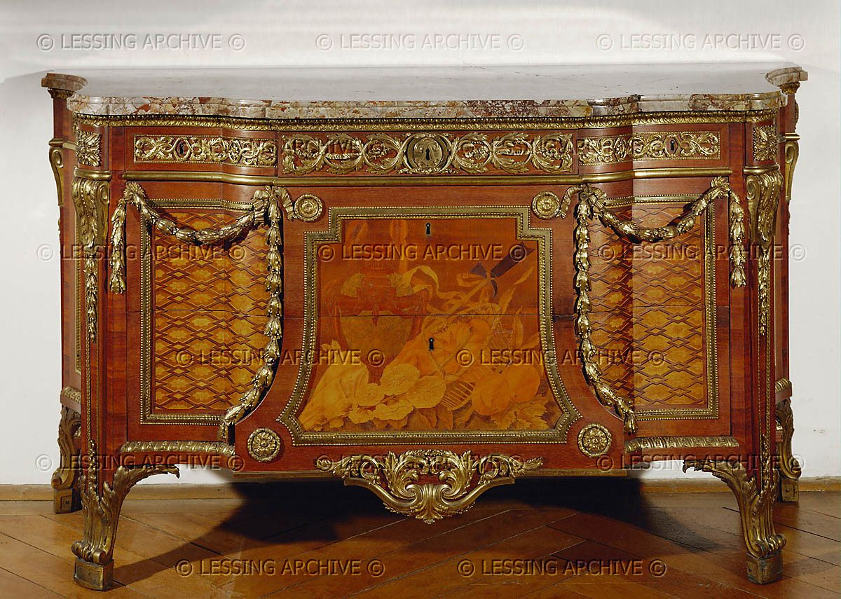 Riesener,Jean-Henri.Chest - commode - intarsia, various woods, gilded bronze fittings, marble top. Center panel: basket with fruit and flowers. Paris, 1778. Inv.H 1969 From the Cabinet de retraite of Louis XVI in Fontainebleau. Gift of Clarisse Rothschild.