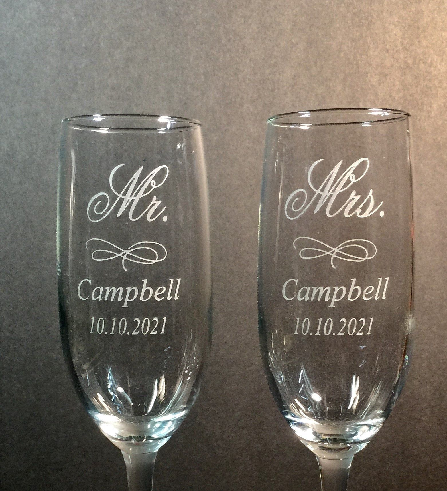 Etched Champagne Flutes Set Of 2 Mr Mrs Last Name Date Etsy In 2021 Engraved Champagne Flutes Wedding Flutes Personalized Etched Glasses Wedding