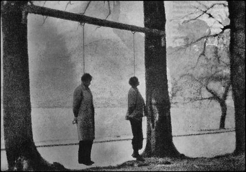 by Costas Balafas Resistance fighters Todoulos and Faridis hang from trees near the lake of Ioannina, Greece, 1944. To avoid the Nazi guards, Balafas took the picture through a mesh bag of onions. [x]