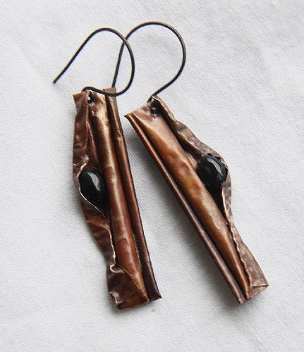 thin copper sheet was textured-heat oxidised-vaxed rolled/folded; onyx cabochons (oblivionjewelry, Etsy) put in folds; oxidised copper ear wires from hummingbirdssupply, Etsy