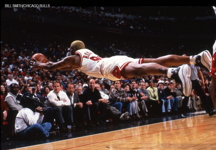 Dennis Rodman lays out to save a possession in this iconic