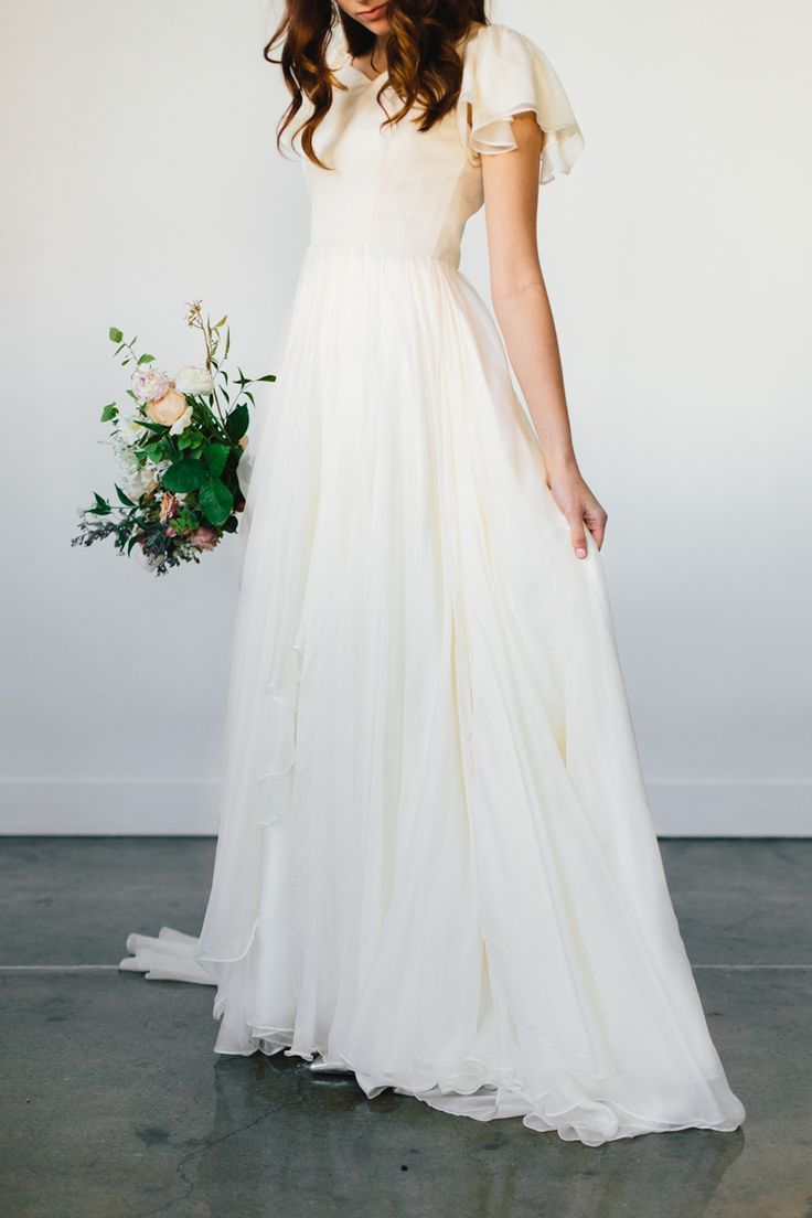 modest wedding dress with flutter sleeves and a trumpet skirt from alta moda (modest bridal gown)