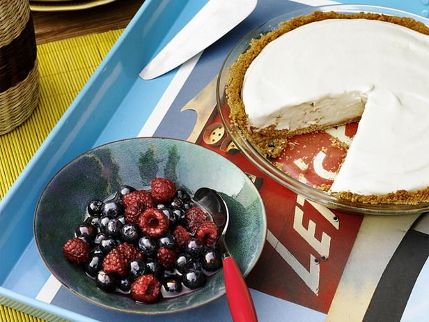 frozen lemonade pie with mixed berry topping
