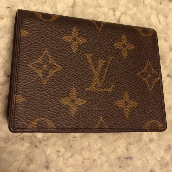 Louis Vuitton Card Case Inspired = fake!!! In great condition!! No tears, scratches or stains. This wallet has 3 slots for cards and a section for your license. Please let me know if you need more pictures. Open to negotiations within reason. Louis Vuitton Accessories Key & Card Holders