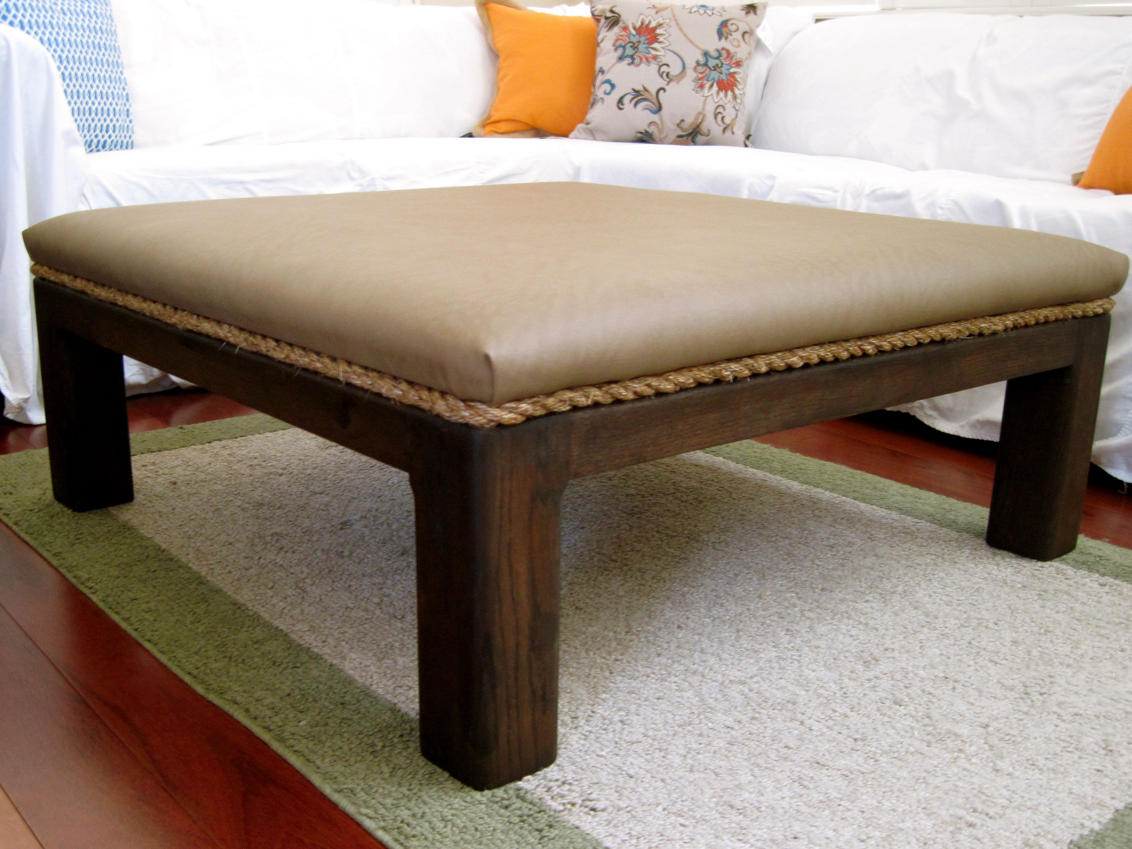 From 80's parquet coffee table to a sleek padded ottoman with a dark kona high gloss finish.