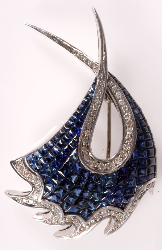 An Art Deco 18ct white gold sapphire and diamond set pin brooch.