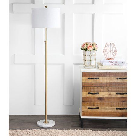 Adjustable floor lamp in brass is weighted by a beautiful (and sturdy!) marble base. #JonathanY #HomeDecor #Lamps #DesignerLamps #ModernLighting #FloorLamp #LampInspiration