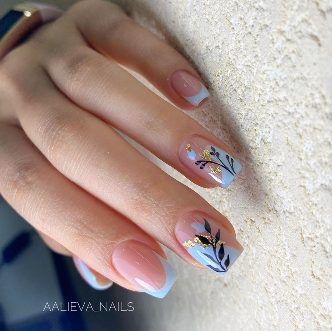 Blue french with leaves nails