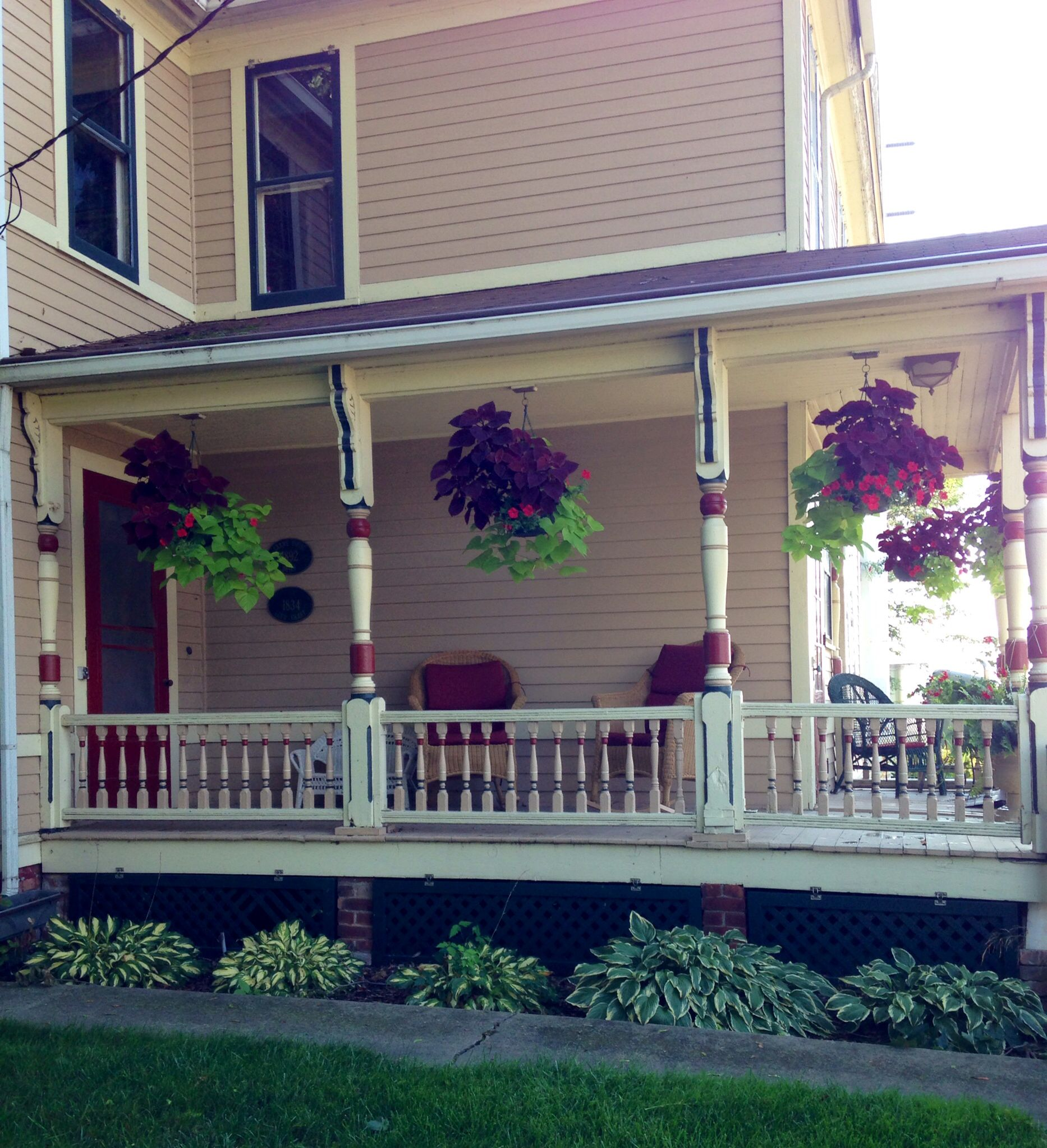 Hostas and hanging baskets along the front porch 2014.