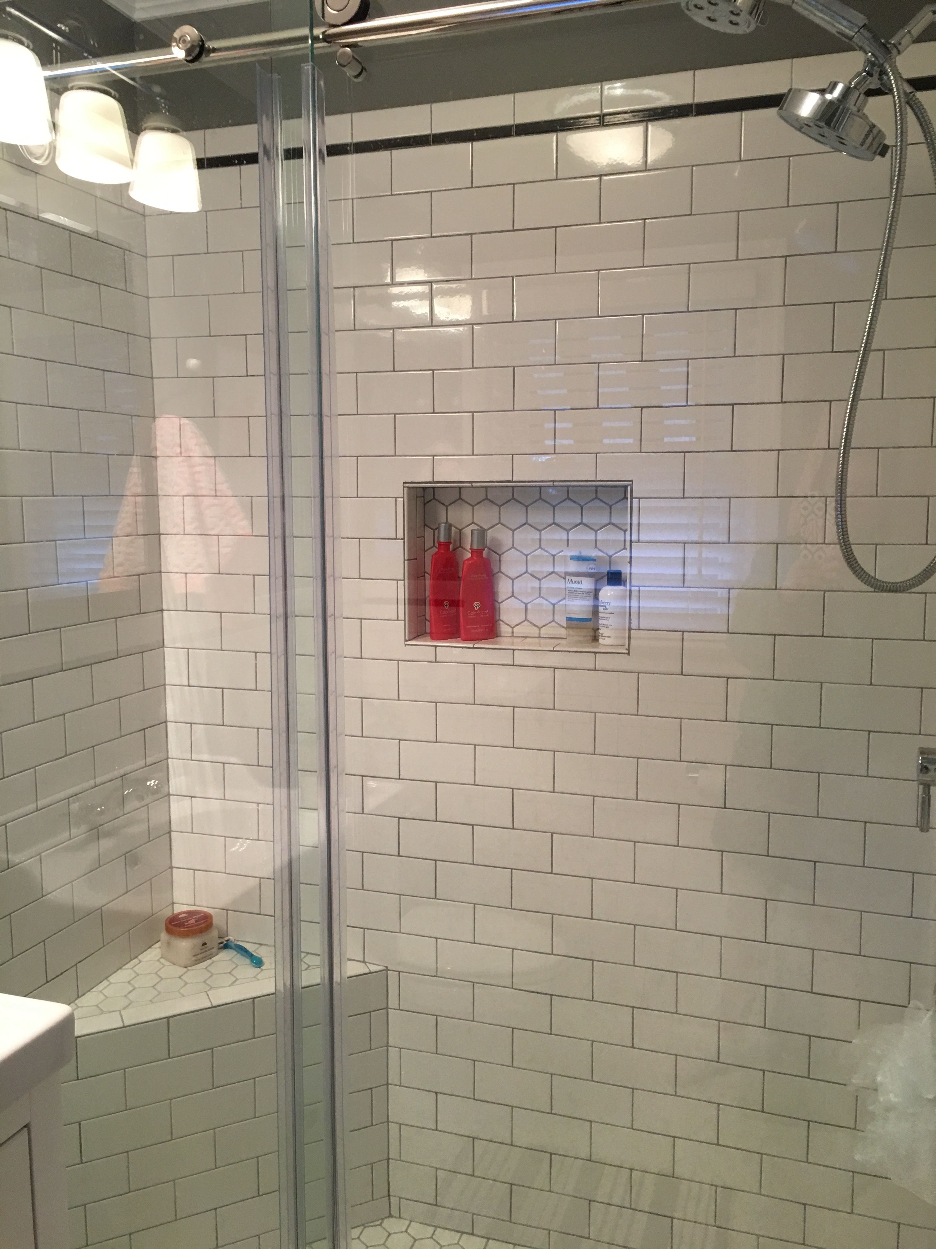 Subway tile and 2 in hex tile on the floor Delorean grey grout and