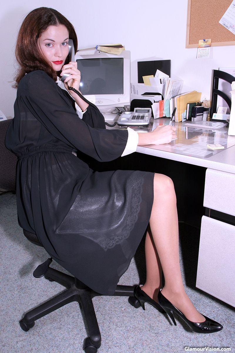 foto de Teresa at work in black crepe dress white half slip