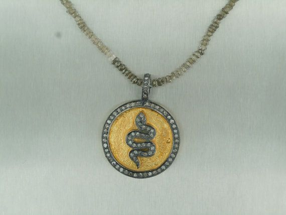 diamond and gold snake pendant on a diamond rondelle necklace.