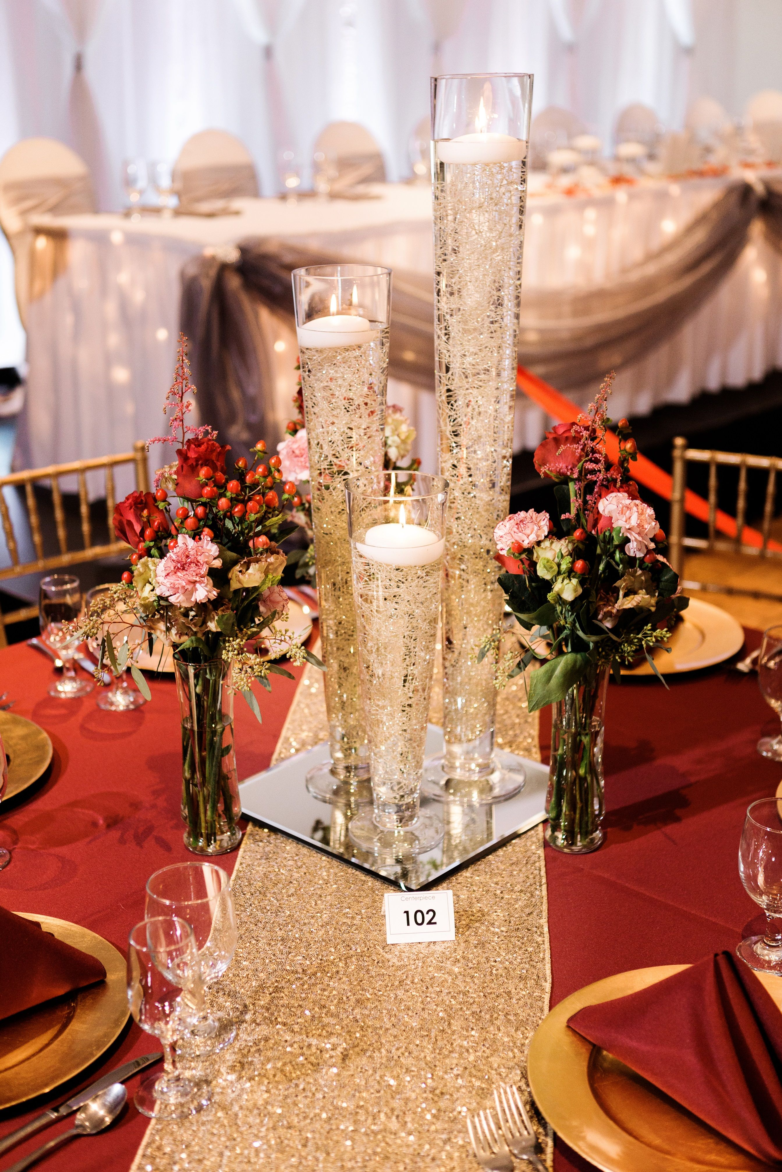 Wedding decor maroon and gold  Centerpiece created by Cerutius Floral and Decor Team Photography