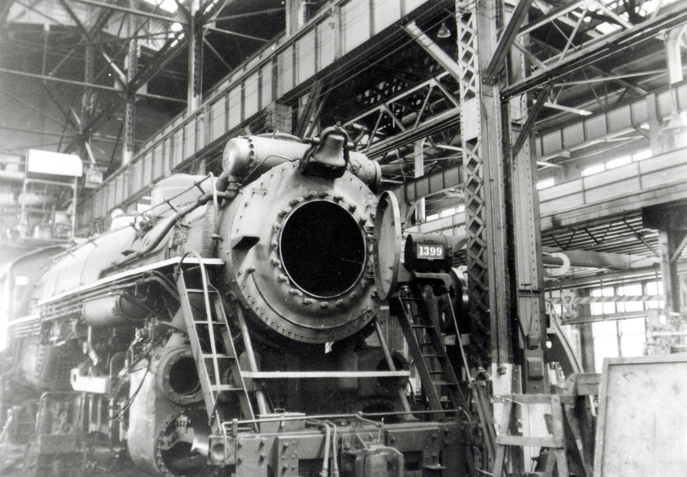 The overhaul of a steam lo otive in the Back Shop of Southern