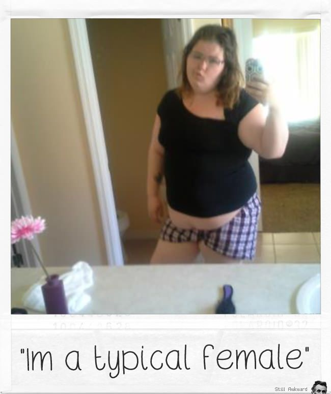 Funny online dating profile photo of a girl taking a pic in the mirror