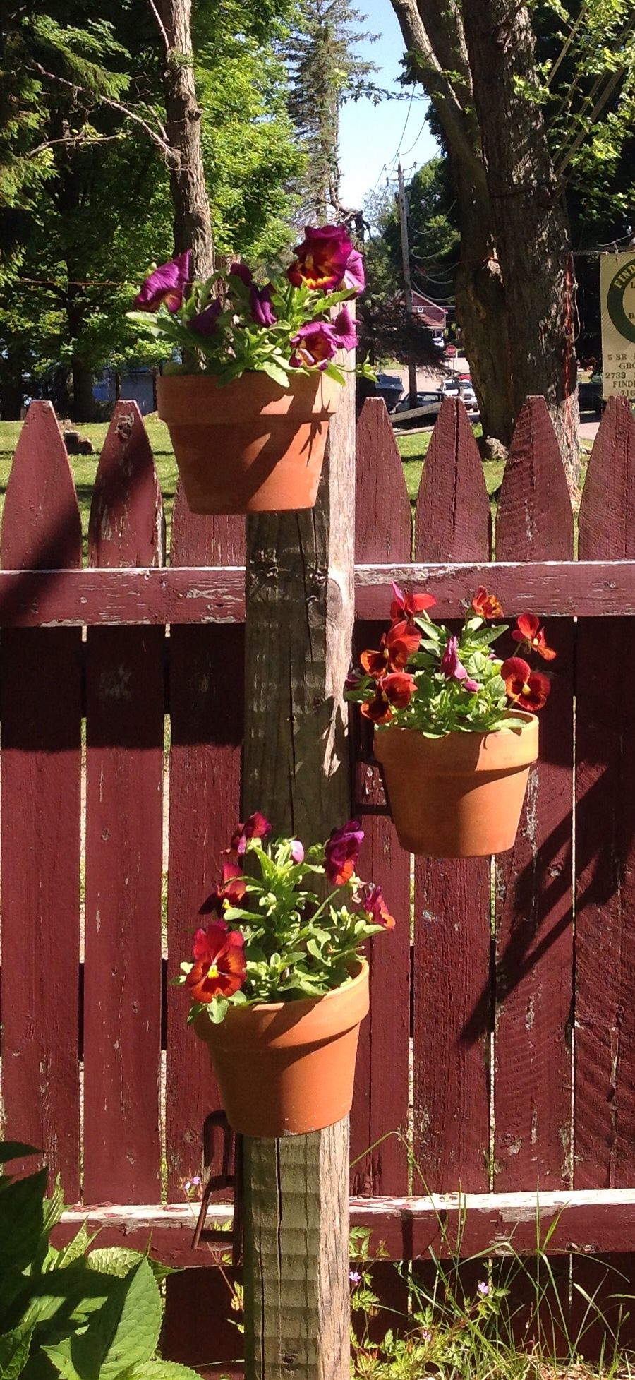 Diy A Seasonal Flower Pole Sink Fence Post Attach Hangapot Hangers In Spiral Or Tered Design Hang Clay Pots Of Pansies Strawberries The