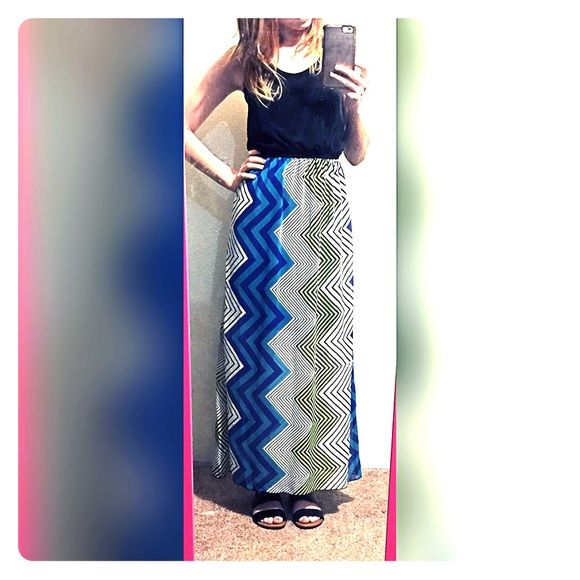 """☀️Cute maxi dress☀️ So cute Sweet Storm Maxi dress. Black top, scrunched in the middle. The skirt part of it is a chevron pattern with some blue and greenish yellow neon color. I'm 5'4"""" and it lands right at my ankles. No rips, stains, or tears. Perfect condition! Comment if you have any questions ☺️ ❌ Trades ❌ PayPal Sweet Storm Dresses Maxi"""