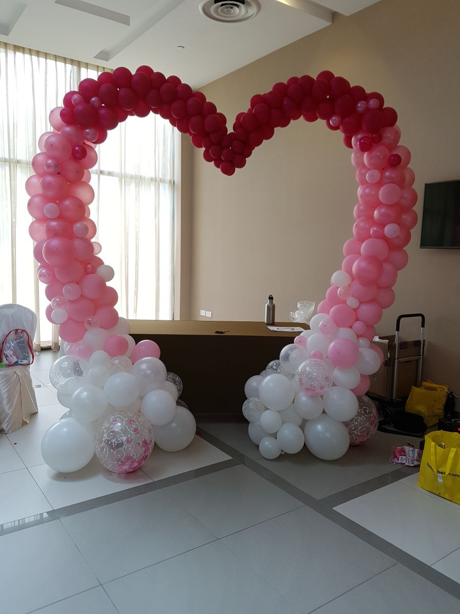 Lovely heart shaped balloon arch for weddings and events #balloonarch