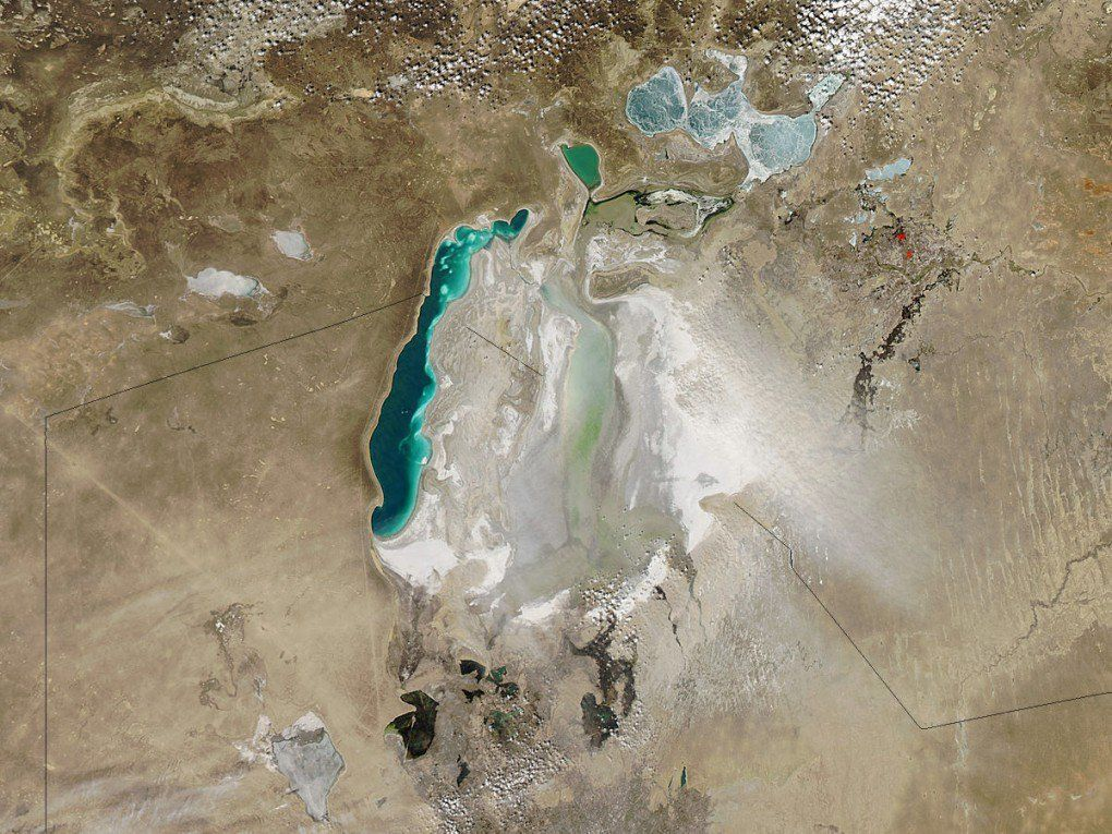 Dust storm on the dry bed of the Aral Sea, along the Kazakhstan-Uzbekistan border. [NASA]