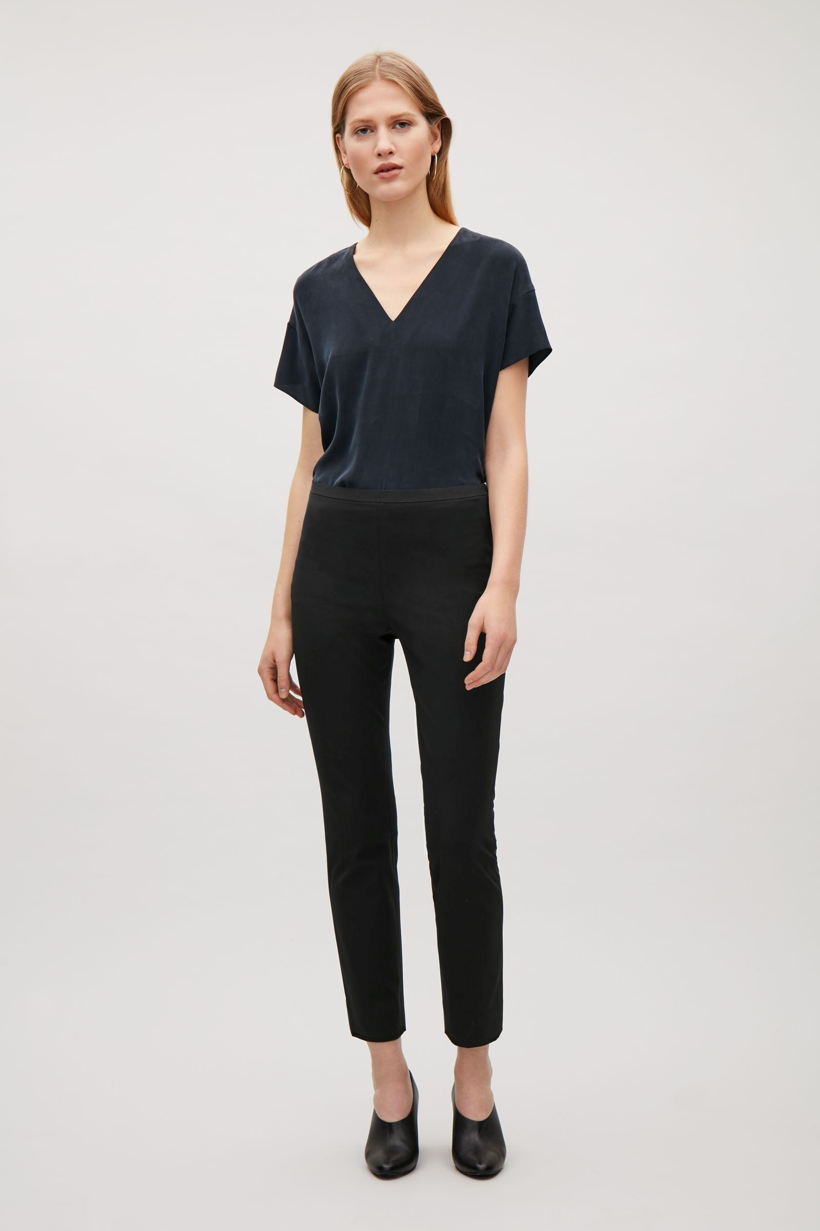 COS image 1 of Slim trousers with grosgrain waist in Black
