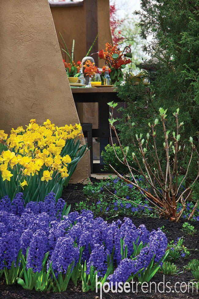 Perennial flowers perk up a patio designed by Landfare LTD. #housetrends http://www.landfareltd.com