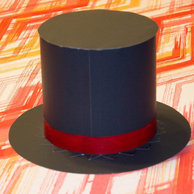 Magicians traditionally wear a black top hat. From this hat, the magician makes things appear or disappear. There are many ways you can make your own inexpensive magician's hat. One simple and practical way to make a magician's hat is from paper. The thickness of the paper .
