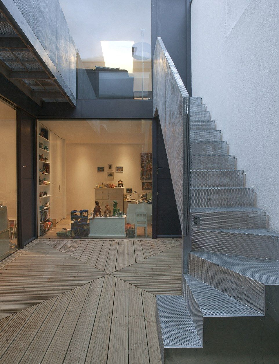 The mesh metal staircase in Vaulted House - and a young family member's bedroom, crammed w...