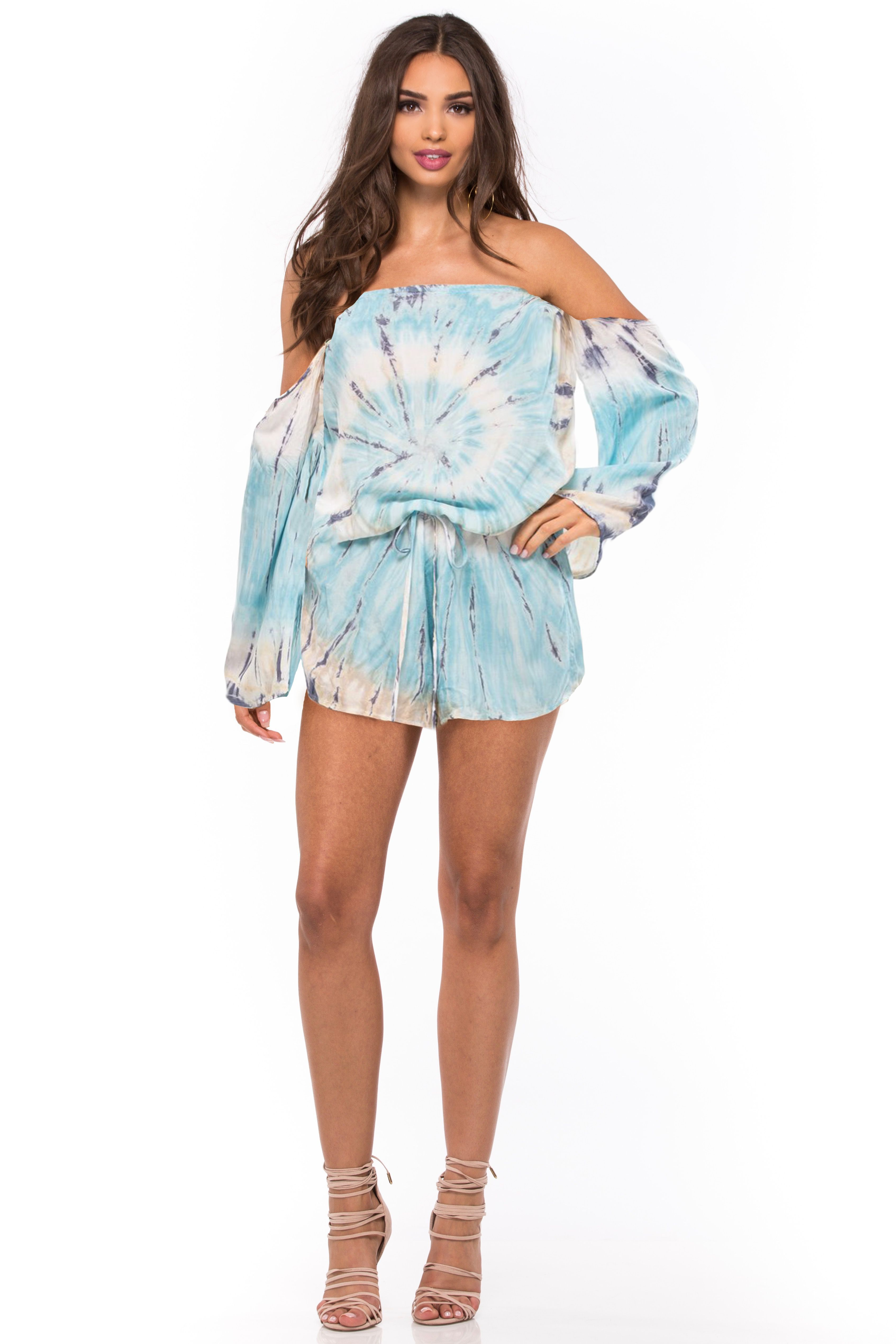 1f58936aa2c8 This flowy and fun romper by Blue Life features off the shoulder detail  with long bell sleeves and a drawstring waist. Hand tie-dye.