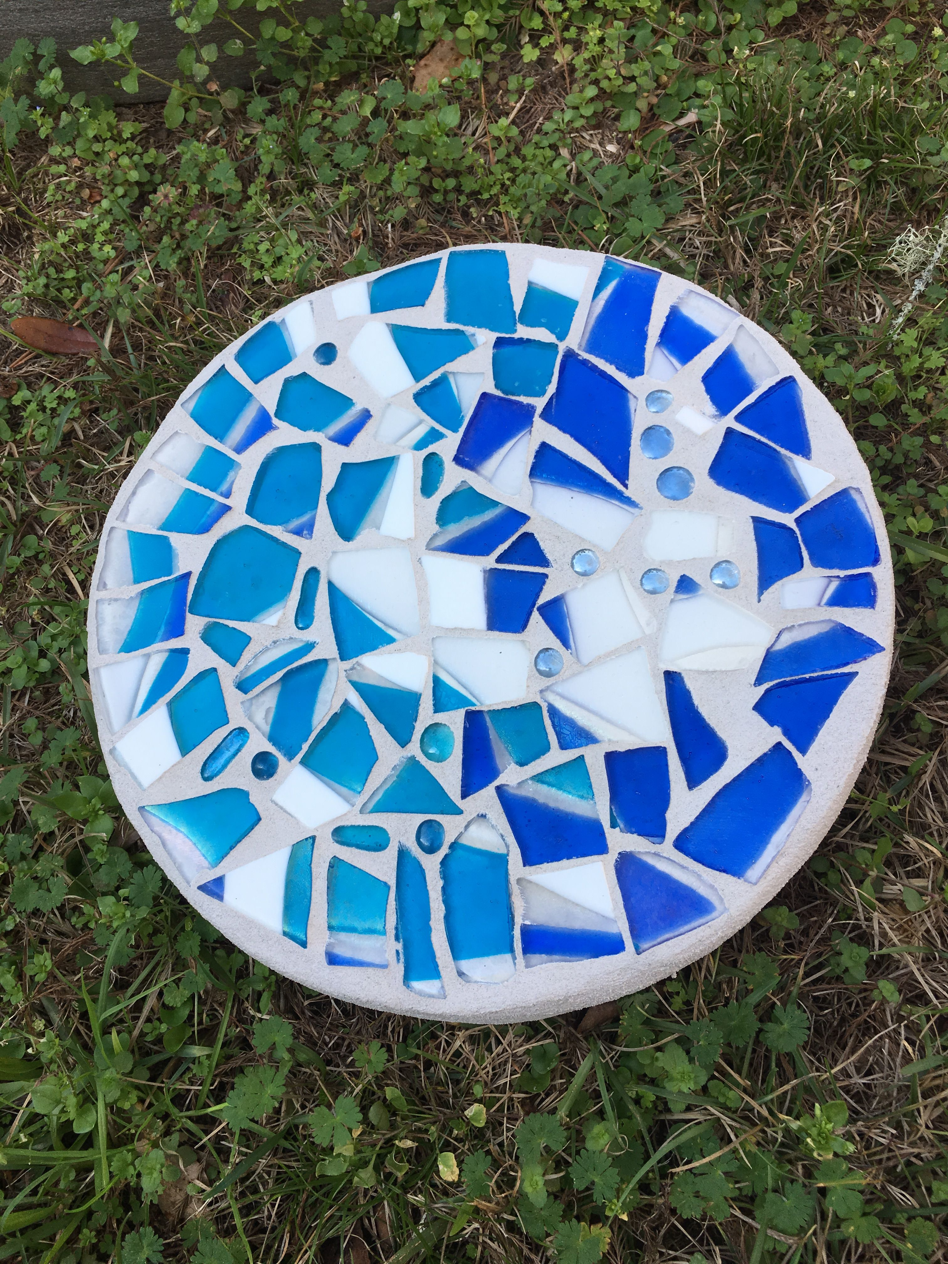 Round 12 inch mosaic stepping stone. Broken glass from